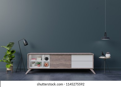 Cabinet TV in empty interior room ,dark wall wall with wood shelf,lamp ,plants and table wood ,3d rendering