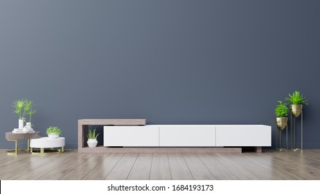 Cabinet TV in empty interior room ,dark blue wall with wood shelf,lamp ,plants and table wood ,3d rendering