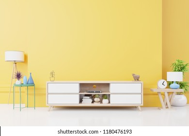 Cabinet TV in modern living room with lamp,table,flower and plant on yellow wall background,3d rendering