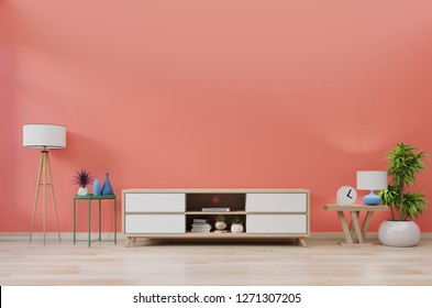 Cabinet TV in modern room with decoration on wooden living coral color wall background,3d rendering