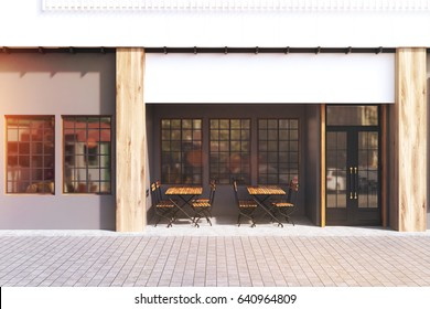 Cafe exterior with gray walls and two wooden tables with chairs standing near a door. 3d rendering, toned image