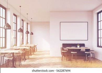 Cafe interior with a large sofa near a white wall, a row of tables with chairs near windows and a big horizontal poster on the wall, wooden floor. 3d rendering. Mock up. Toned image