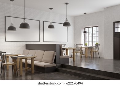 Cafe interior with two framed horizontal posters on a wall, square tables, sofas and chairs. 3d rendering, mock up