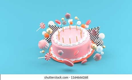 Cake among colorful balls on a blue background.-3d rendering.