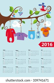 calendar 2016baby clothes for newborn baby boy hanging on the rope on the branches