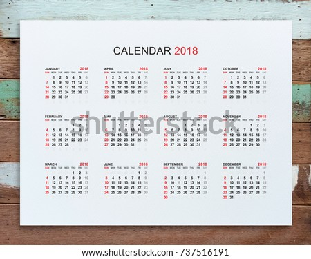 calendar 2018 year in simple style on white paper with wood background week starts from