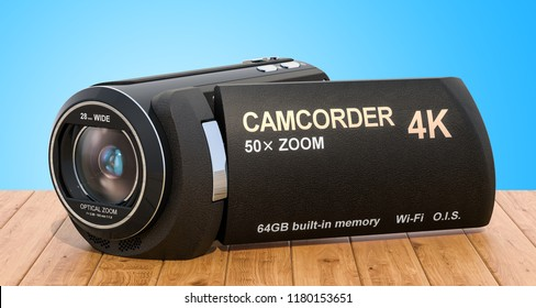 Camcorder, videocamera on the wooden desk. 3D rendering