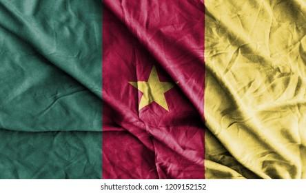 Cameroon Flag 3D Illustration On The Fold Fabric. Cameroon  Flag Painting On The Fabric. 3D Rendering.
