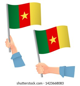 Cameroon flag in hand. Patriotic background. National flag of Cameroon  illustration