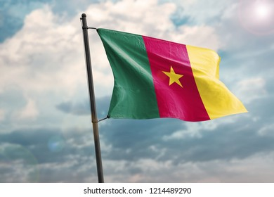 Cameroon flag waving wind On Sky Background. 3D illustration of wave and fabric Cameroon flag.