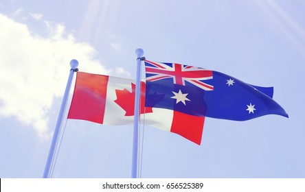 Canada and Australia, two flags waving against blue sky. 3d image