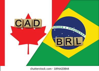Canada and Brazil currencies codes on national flags background. International money transfer concept