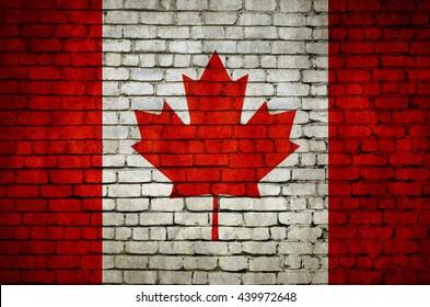 Canadian flag on a brick wall. Canadian flag.Canadian flag. Canadian flag. Canada. Canada. Canada. Canada.