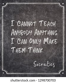I cannot teach anybody anything. I can only make them think - ancient Greek philosopher Socrates quote written on framed chalkboard