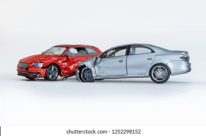 Car accident. Generic car crashed. Silver sedan car crashed against a red coupè. Isolated on white background. 3D rendering.