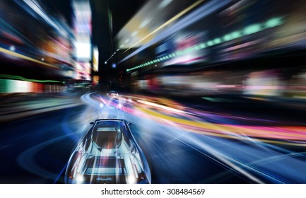 car traveling fast through the city