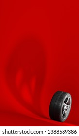 Car wheel isolated on a red background. Tyre. Poster booklet cover design. Ghost shadow. 3d illustration