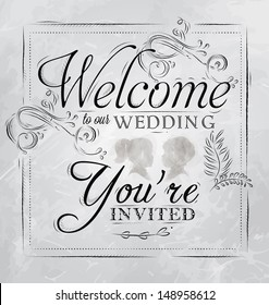 Card lettering welcome to our wedding you invited, in retro style drawing with coal on board.