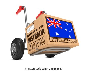 Cardboard Box with Flag of Australia and Made in Australia Slogan on Hand Truck White Background. Free Shipping Concept.