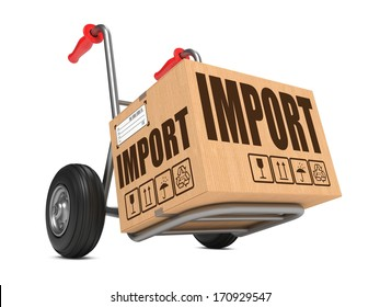Cardboard Box with Import Slogan on Hand Truck White Background.
