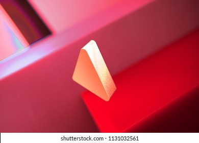 Caret Left Icon on the Red Geometric Background. 3D Illustration of Metallic Arrow, Back, Care, Caret, Left, Previous Icon Set With Color Boxes on Red Background.