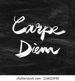 Carpe diem. Handwritten quote on the chalkboard. Inspiring art print