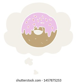 cartoon donut with thought bubble in retro style
