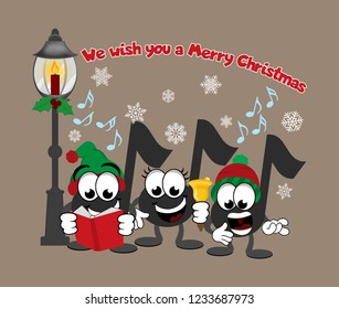 Cartoon music notes celebrating christmas.  Three carolers, one holding a song book, one playing a hand bell, and one singing, with a street lamp and snow falling in background.