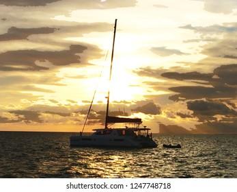 Catamaran at anchor during sunset watercolor