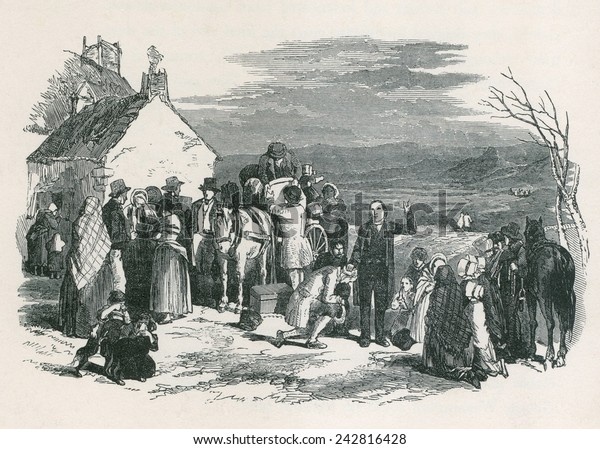 A Catholic priest blesses kneeling immigrants as they to leave their homes and families in Ireland for North America during the potato famine. Ca. 1850.