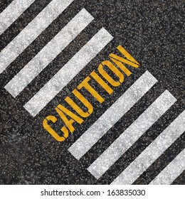 caution concept : paint on asphalt road