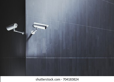 CCTV cameras on tile building exterior with copy space. Surveillance concept. 3D Rendering