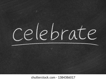 celebrate concept word on a blackboard background