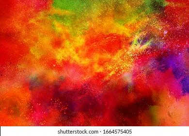 Celebrate festival Holi. Indian Holi festival of colours. Colorful powder explosion on black background.