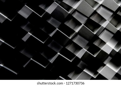 Cellular wall structure. Grunge material background of abstract architecture with zigzag pattern. Modern composition in shades of gray and black.