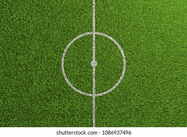 Centerline on grass of soccer and football field with center circle and kick-off point (3D Rendering)