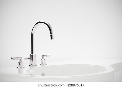 Ceramic sink with chrome fixture on white background