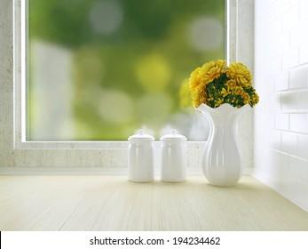 Ceramic tableware on the wooden worktop. White kitchen design.