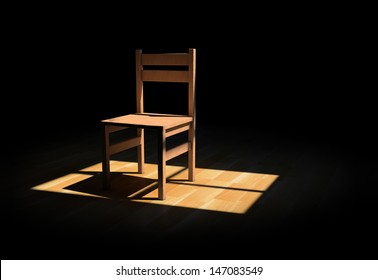 Chair on a dark room illuminated only by a light coming from a window
