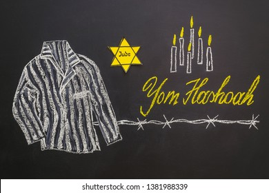 Chalk inscription Yom HaShoah (Holocaust Memorial Day) and striped prison uniform of concentration camp prisoners drawn on a chalk board