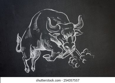 chalk on blackboard illustration of a wild charging bull bucking and snorting