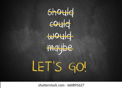 "chalkboard with stroked words like could and should and ""Let's go"" at the bottom"