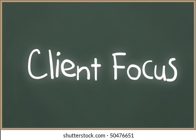 Chalkboard with wooden frame and the text Client Focus