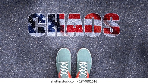Chaos and politics in the USA, symbolized as a person standing in front of the phrase Chaos in American flag colors to show that  Chaos is related to politics and each person's choice, 3d illustration