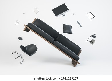 Chaos and zero gravity concept with flying black sofa, office chair, computer monitor, lamp and notebooks. 3D rendering