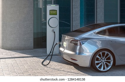 Charging an EV electric sedan car with silver paint in a city parking lot 3d illustration
