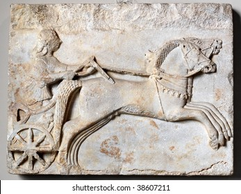 Charioteer driving two horses. Archaic period, 6th century BC.