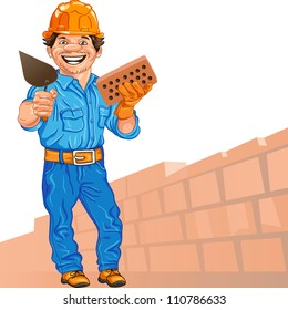 cheerful mason in the orange helmet with brick and trowel in hand, against a background of brick wall