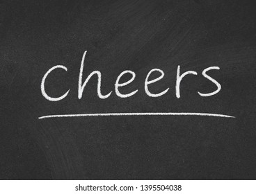 cheers concept word on a blackboard background