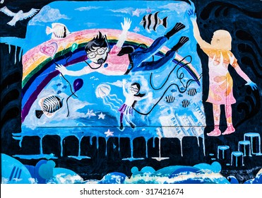 CHIANGMAI, THAILAND - September 11, 2015. wall painted show children swimming with fishes at U.S. Consulate office wall in occasion of 180 years U.S.-THAI RELATIONS by Wichai wittaya bilingual school